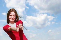 Happy girl on sky background Stock Image