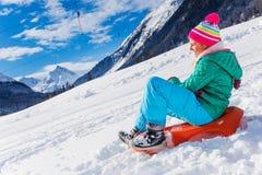 Happy girl sledding Royalty Free Stock Photos