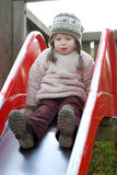Happy girl on a slide Royalty Free Stock Photos