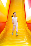 Happy Girl on Slide Stock Photo