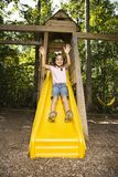 Happy girl sliding. Royalty Free Stock Photo