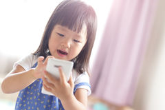 Happy girl with smart phone Royalty Free Stock Photography