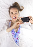 Happy girl with smartphone Stock Images