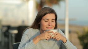 Happy girl smelling coffee aroma in slow motion stock footage
