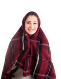 Happy girl smile covered with blanket isolated Royalty Free Stock Photos