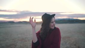 Happy girl smiles in the field at sunset stock video footage