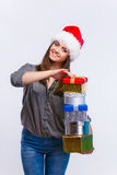 Happy girl. Smiling happy girl in christmas hat with gifts in her hair Royalty Free Stock Photo