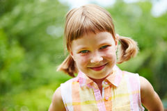 Happy girl smiling in garden Royalty Free Stock Images