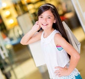 Happy girl smiling at the mall Royalty Free Stock Photo