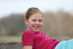 Happy girl smiling outdoors Stock Photo