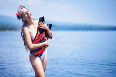 Happy girl after snorkeling. Happy girl on a beach after snorkeling Royalty Free Stock Photo