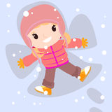 Happy girl in snow making angel. Royalty Free Stock Photography