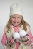 Happy girl with snowballs Royalty Free Stock Image