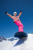 Happy girl on snowboard Royalty Free Stock Image