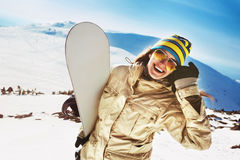 Happy girl snowboarder having fun Royalty Free Stock Images