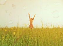Happy girl among soap bubbles Stock Photo
