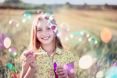 Happy girl with soap bubbles Royalty Free Stock Image