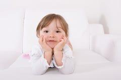 Happy girl on sofa Stock Photos