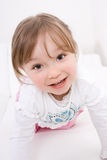 Happy girl on sofa Stock Photography