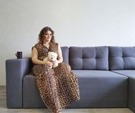 Happy girl the sofa teddy bear toy tenderness emotions holding relax stock photos
