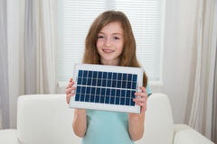 Happy Girl With Solar Panel Royalty Free Stock Photo