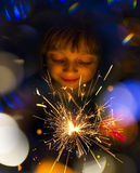 Happy girl with a sparkler Stock Images