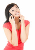 Happy girl speaking on the phone and looking up. White background Royalty Free Stock Photos