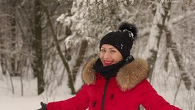 Happy girl spinning under heavy snow in the Park. Young woman enjoying winter day outdoors. Happy girl spinning under heavy snow in the Park. Snow winter dream stock video