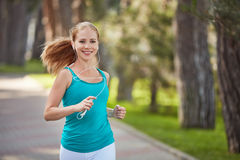 Happy girl in for sports and fitness jogging  in the summer Royalty Free Stock Photos