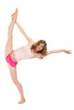 Happy girl in sportswear does gymnastic exercise. On white background Stock Image