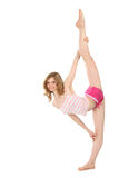 Happy girl in sportswear does gymnastic exercise. On white background Royalty Free Stock Photos