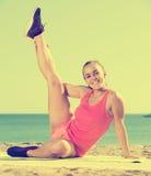 Happy girl in sportswear practice  yoga at sea beach Royalty Free Stock Photo