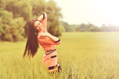 Happy girl in a spring field Stock Photo