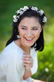 Happy girl spring wreath of flowers in the head royalty free stock photography