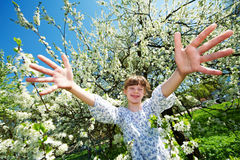 Happy girl in springtime blossom park Royalty Free Stock Images