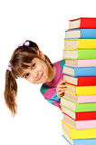 Happy girl with stack color books. Stock Photo