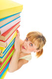 Happy girl with stack color books. Isolated Stock Photo