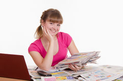 Happy girl with a stack of newspapers Royalty Free Stock Photography