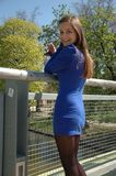 Happy girl standing on bridge Stock Images