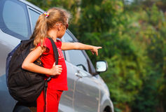 Happy girl standing near the car Royalty Free Stock Images