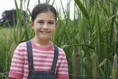 Happy Girl Standing Beside Reeds Stock Images