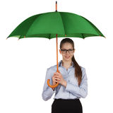 Happy girl standing under a umbrella Stock Image