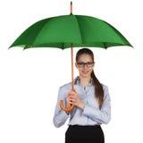 Happy girl standing under a umbrella Stock Image