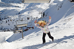 Happy Girl Stands On Mountains Ski Slope Royalty Free Stock Image