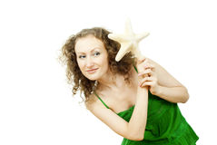 Happy girl with the starfish Royalty Free Stock Image