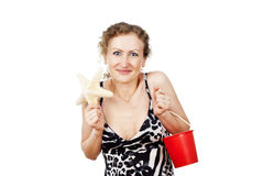 Happy girl with the starfish and bucket Royalty Free Stock Images