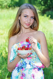 Happy girl with strawberries Royalty Free Stock Images