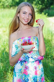 Happy girl with strawberries Royalty Free Stock Photos