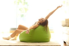 Happy girl stretching at home Royalty Free Stock Photos