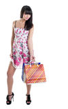 Happy girl with striped bags in transparent dress Royalty Free Stock Photo